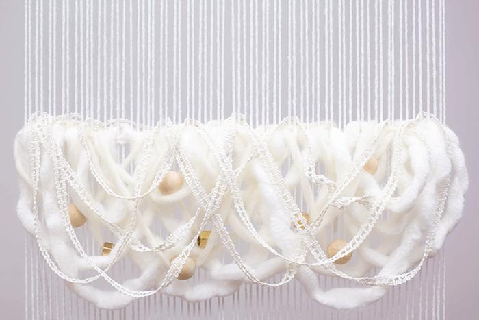 DIY wavy woven fringe loops.