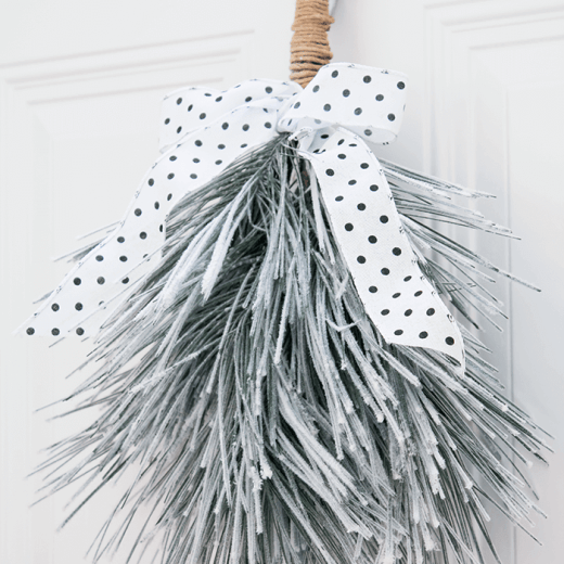 Make a simple winter swag for your front door this season. A great alternative to a traditional wreath.