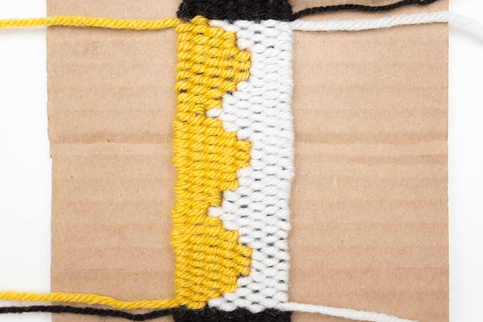 Half circles will look pixelated in weavings, including this handmade bookmark.