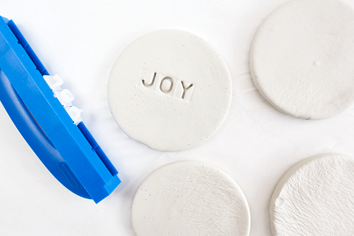 Gently push embossing tool into center of ornament to create an impression.