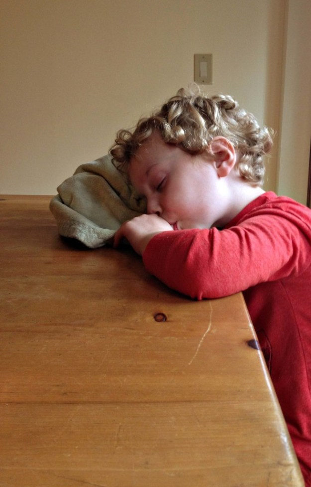 Asleep at the table.