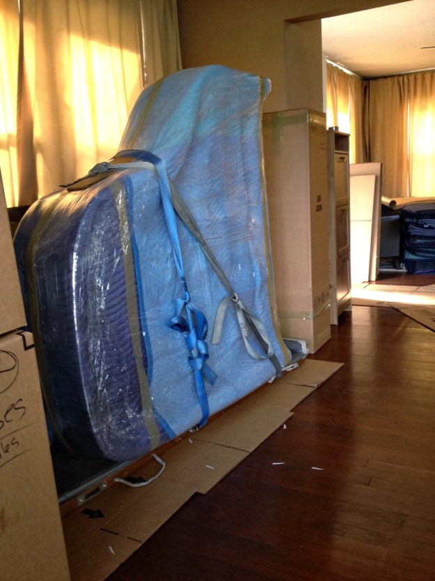 Piano wrapped up and ready to be put on moving truck.