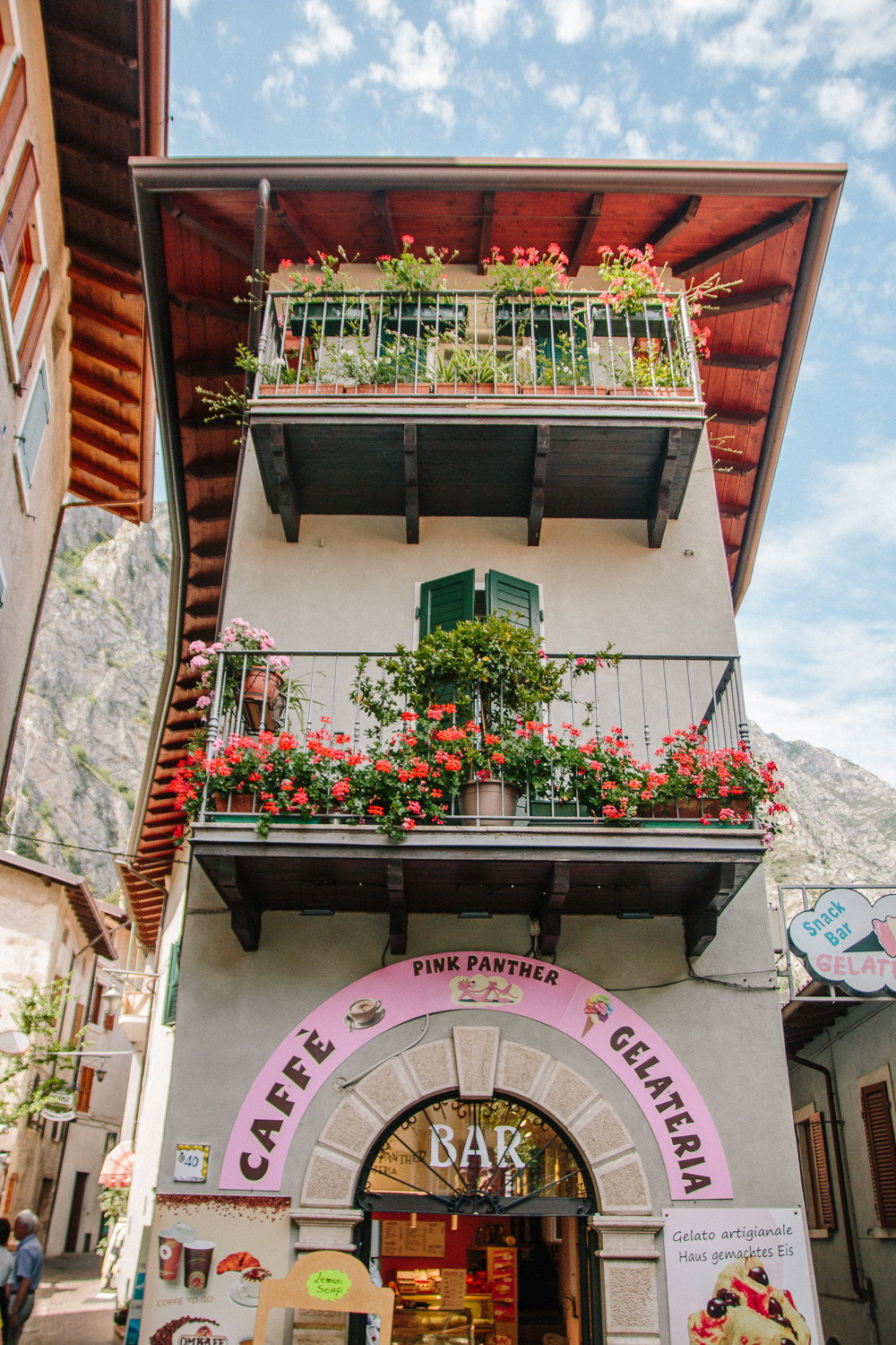 A tall building in Limone, Lake Garda, lined with colourful flower boxes