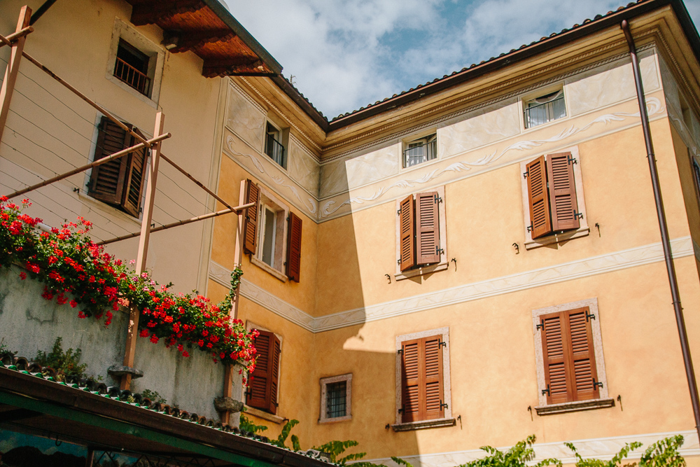 Peach and Yellow Coloured buildings on a street in Limone, Lake Garda