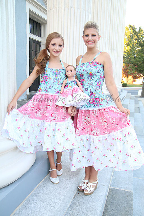 mom and daughter with 18 inch doll matching