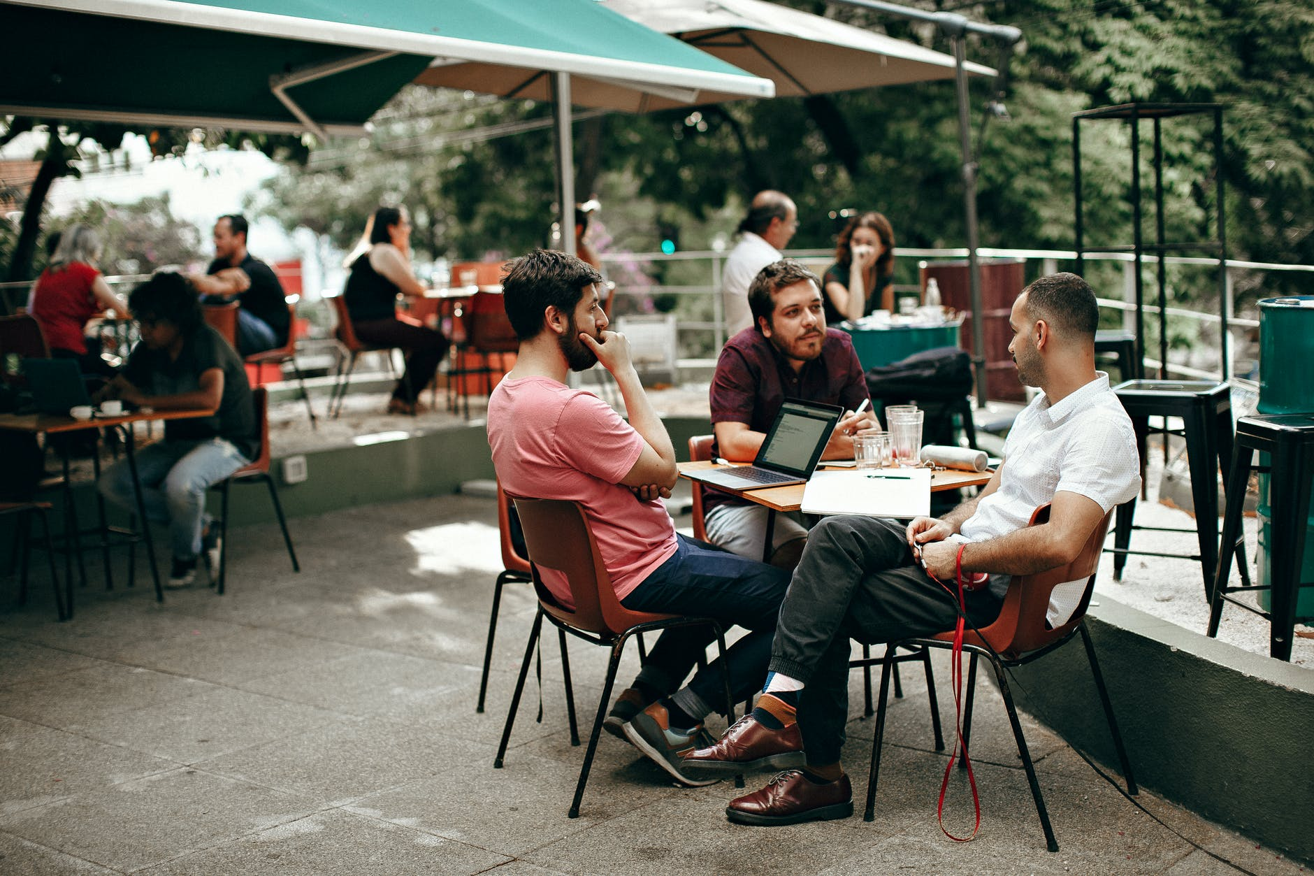 three men sitting at the table