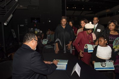 Honorees sign calendars at the Unveiling Ceremony