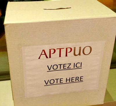 """APTPUO Ballot Box with """"Vote Here"""" written on front."""