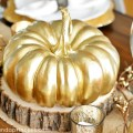 Thanksgiving inspired gold table decor dinner party a pumpkin and