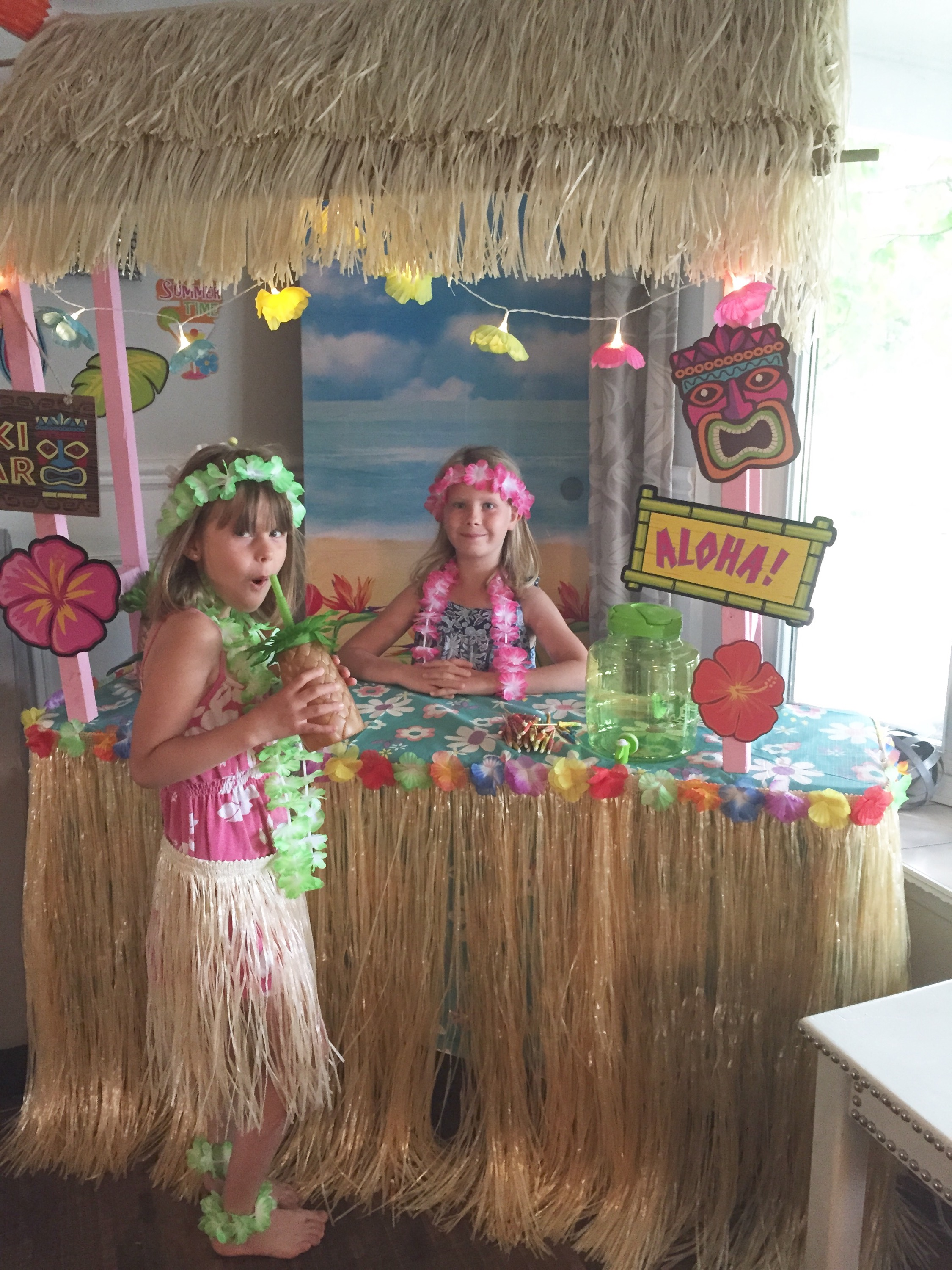 Luau birthday party a purdy little house for How to make luau decorations at home