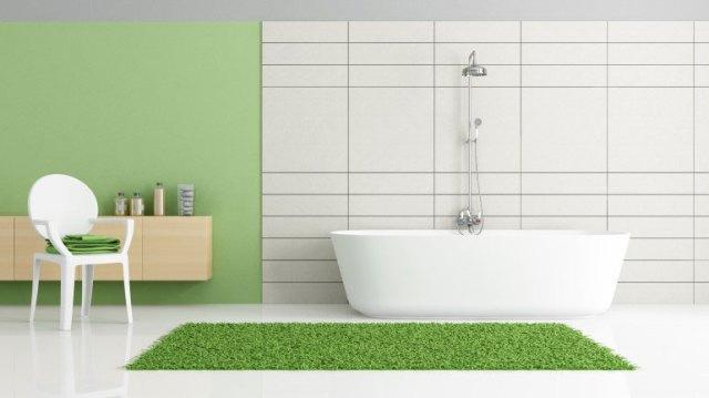 Kamar mandi minimalis dengan aksen hijau