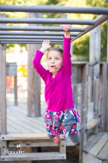 monkey bars, playground, pink dress, nyc