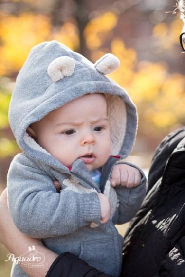 Baby in bear onesie being held by mom in Brooklyn