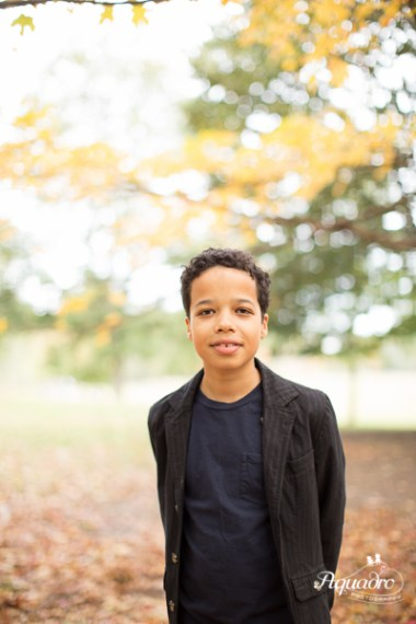 Boy poses for portrait in Brooklyn in autumn