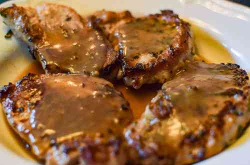 rosemary porkchops with pan gravy on a platter