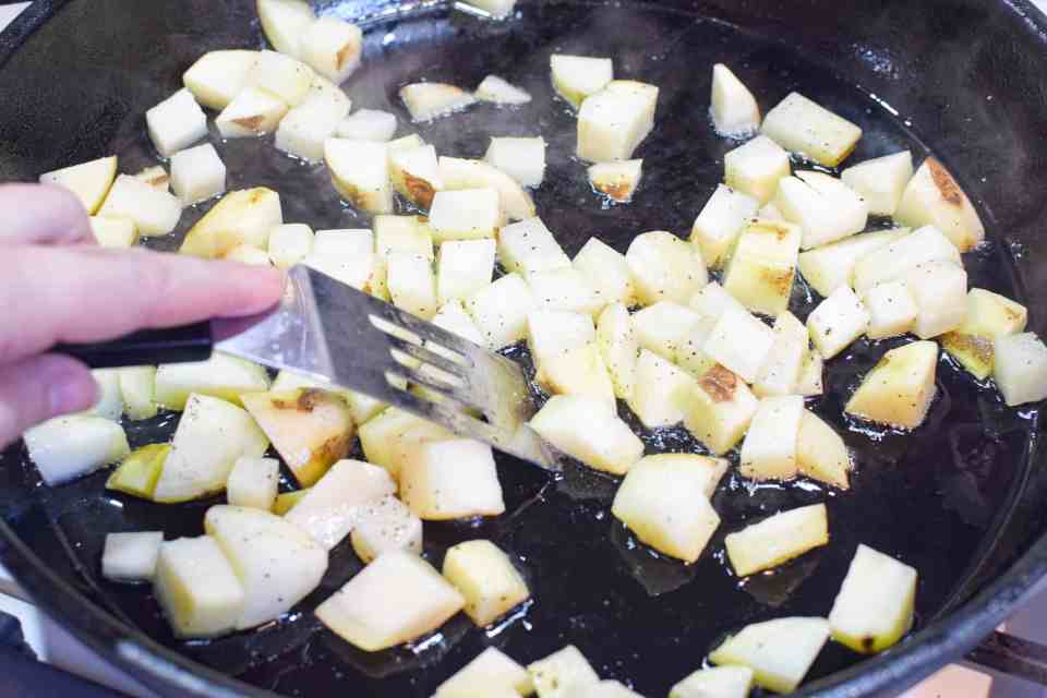 diced potatoes in a cast iron skillet