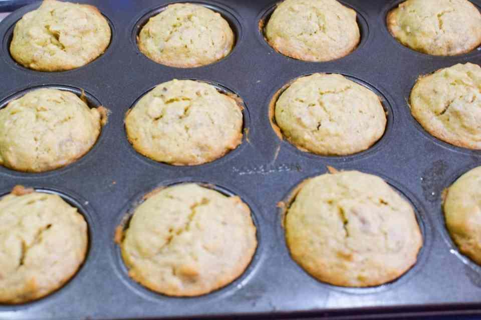 banana nut muffins in a muffin tin