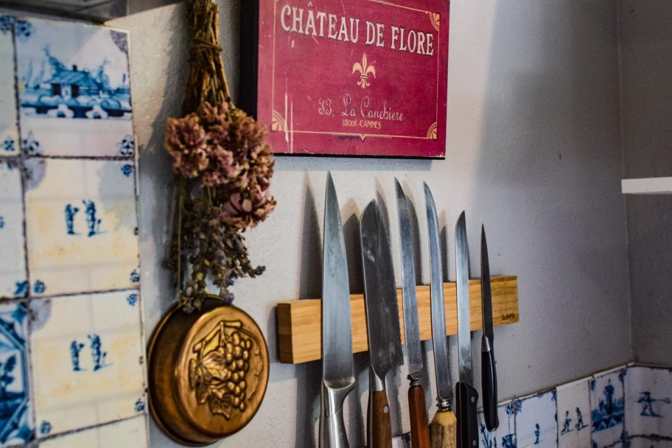 Ways to create a french or old world farmhouse with knives, and herbs hanging