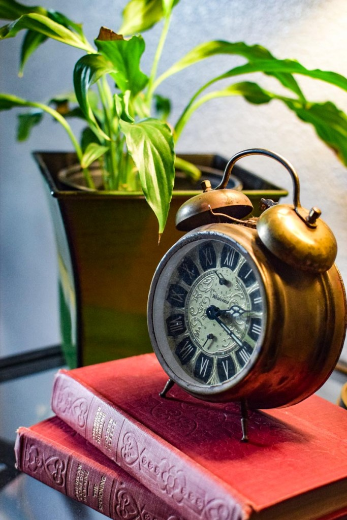 old book and a clock on top shows an old world farmhouse look
