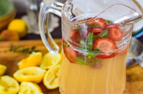 a pitcher filled with strawberry basil lemonade