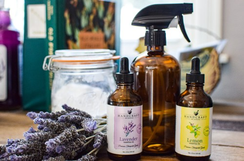 essential oils and a spray bottle for an all natural fabric refresher