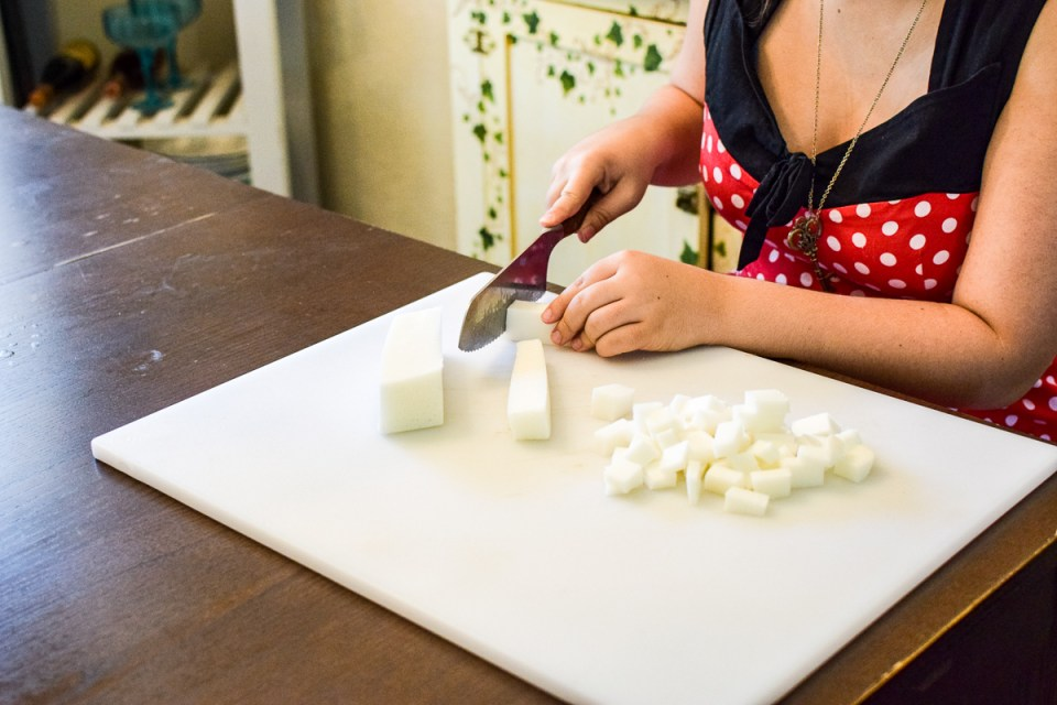 cutting up soap melt and pour soap base to make a simple soap