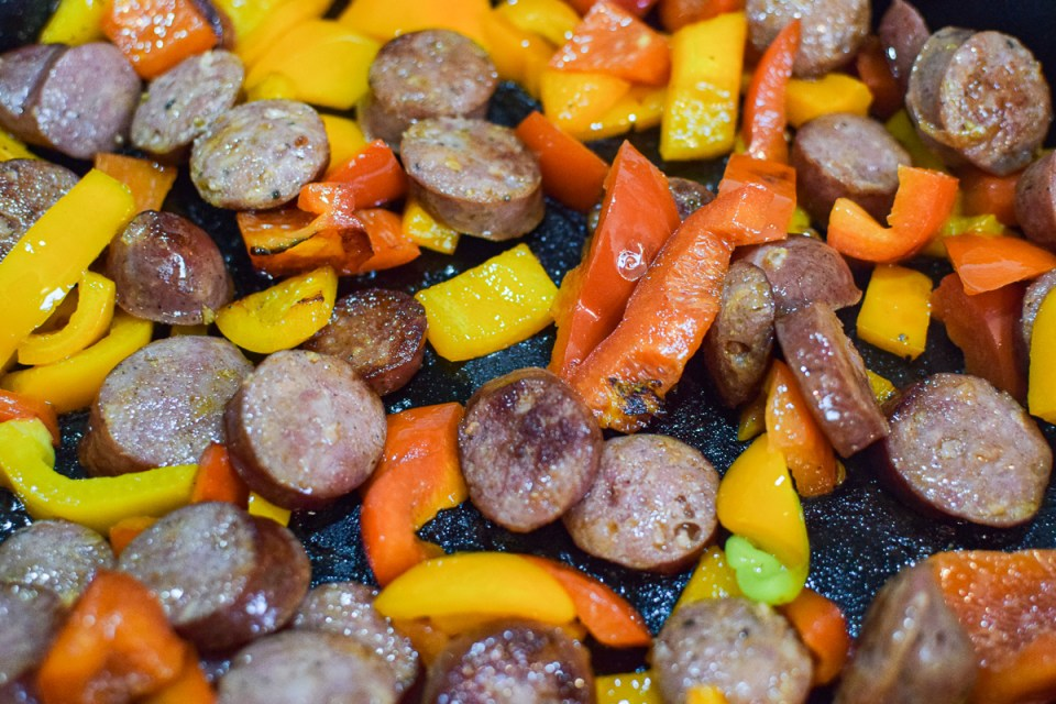 sausages and peppers in a pan
