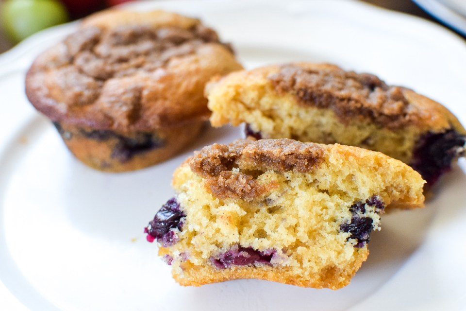 healthy lemon blueberry muffins on a white plate