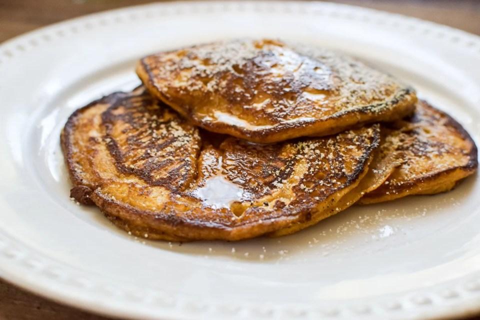homemade pumpkin pancakes on a white plate