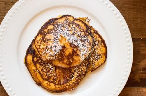 homemade pumpkin pancakes a white platter
