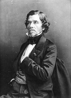 Nadar, Eugène Delacroix assis de trois-quarts face, la main dans le gilet,1858