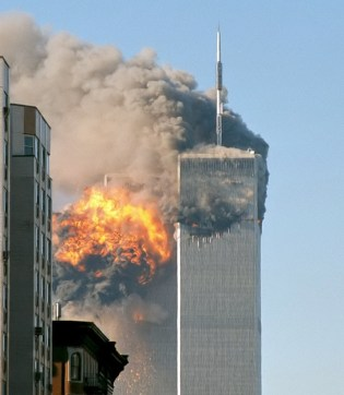 09-11-false flag event-North_face_south_tower_after_plane_strike_9-11