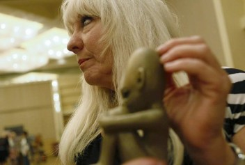[Gauthier, Robert -- B581437132Z.1 IRVINE, CA, FRIDAY, JULY 29, 2011 - Cynthia Crawford caresses a sculpture of an extra-terrestrial child she created from memories of meeting similar beings. Crawford and partner Diane Hamlin, known as the ET Sculptors are selling their figurines at the 2011 MUFON Symposium at the Hyatt Hotel. . (Robert Gauthier/Los Angeles Times)] *** []