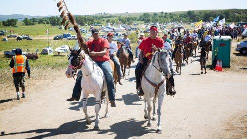 standing-rock-two-men-horseback