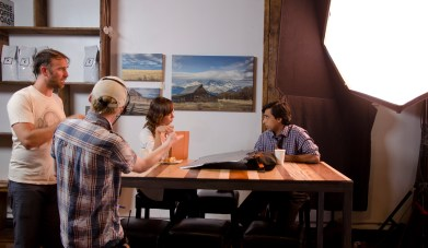 Brittany Allen talking with fellow cast member Anand Rajaram, leading actor, on set.