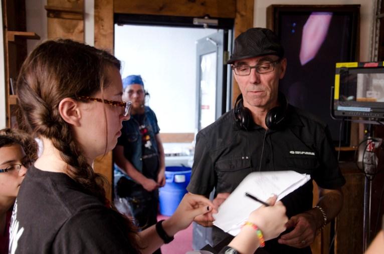 Director's Assistant Lindsay Murray showing Director Daniel O'Conner written scene shot notes.