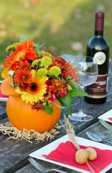 A pumpkin flower centerpiece can be used to add colour to any table top.