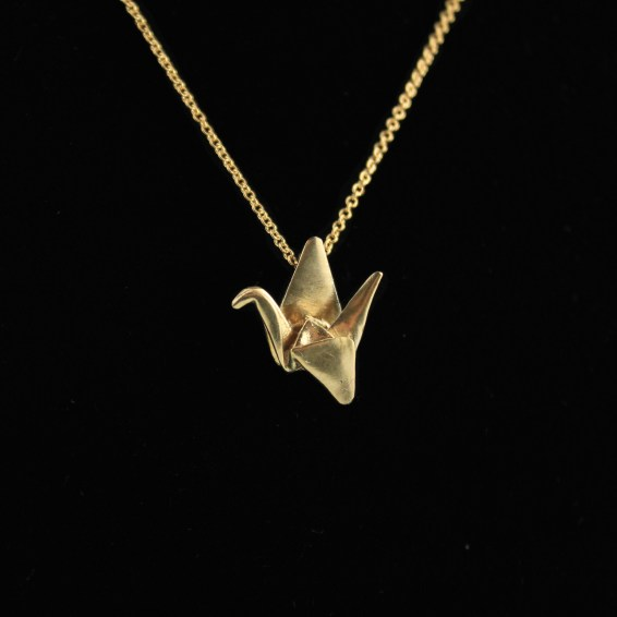 Gold origami crane necklace. Photo by: FoldIT Creations.