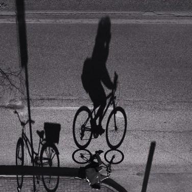 A cyclist commutes on Kennedy Avenue. Photo by: Gage Fletcher. @gage.fletcher/@everydaywinnipeg