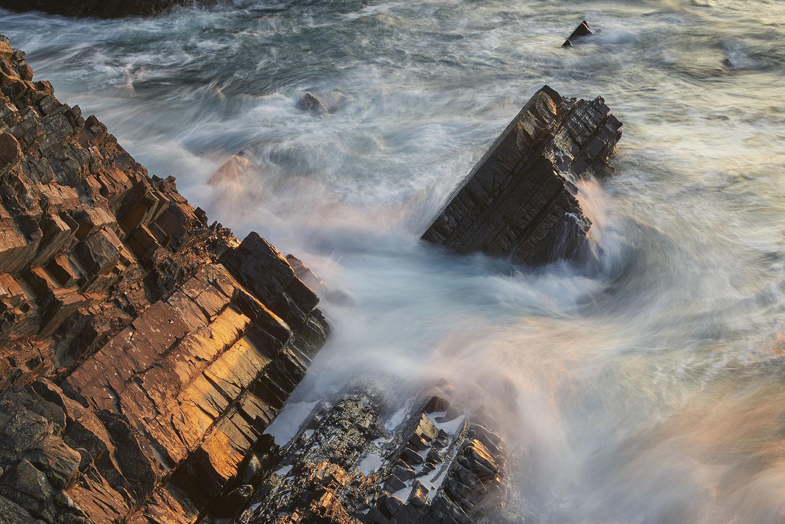 Sunset Shoreline Rocks print; Solid Rocks, Swirling Waves