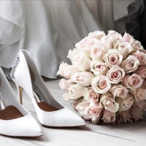 Bride's shoes,  flowers,  and wedding dress