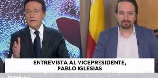 Matías Prats y Pablo Iglesias en la entrevista a través de Antena 3 TV