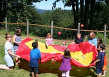 Children playing with Irvina at A Quiet Forest Daycare and Preschool in Duvall, WA