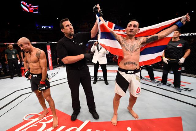 RIO DE JANEIRO, BRAZIL - JUNE 03:  Max Holloway celebrates after his TKO victory over Jose Aldo of Brazil in their UFC featherweight championship bout during the UFC 212 event at Jeunesse Arena on June 3, 2017 in Rio de Janeiro, Brazil. (Photo by Jeff Bottari/Zuffa LLC/Zuffa LLC via Getty Images)