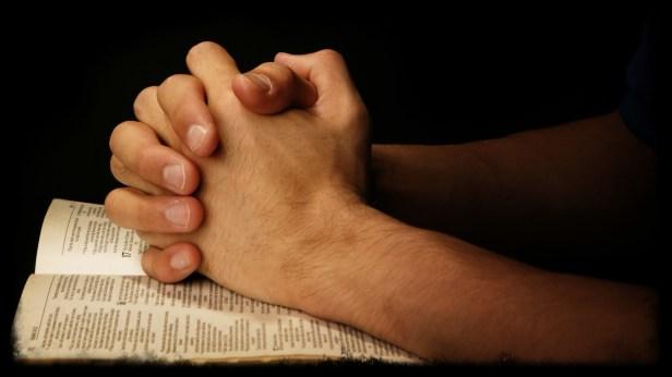 teen-hands-praying-bible