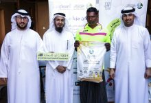 """Photo of A charitable initiative in Dubai to distribute 205 """"jackets"""" to workers"""