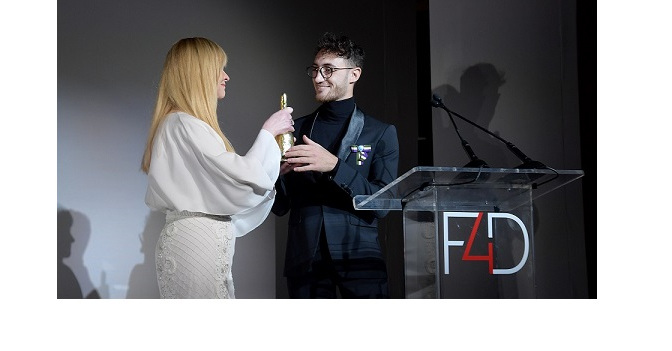 NEW YORK, NEW YORK - SEPTEMBER 24: Evie Evangelou presents and award to Jacob Abrian onstage during Fashion 4 Development's 9th Annual Official First Ladies Luncheon at The Pierre Hotel on September 24, 2019 in New York City. (Photo by Ben Gabbe/Getty Images  for Fashion 4 Development )