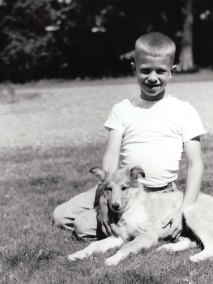 Larry sitting with his dog Lassie in 1957.