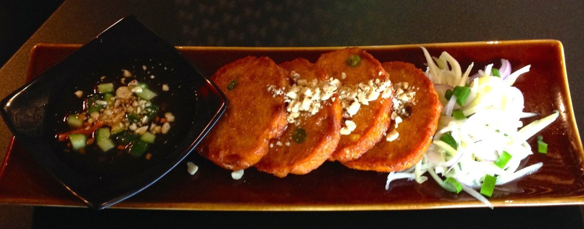 Fish cakes with green mango salad and chilli and palm sugar dip