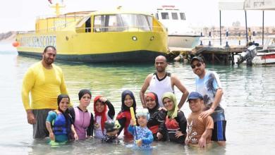 Photo of هذه قصة أول فريق غطس من قصار القامة في مصر